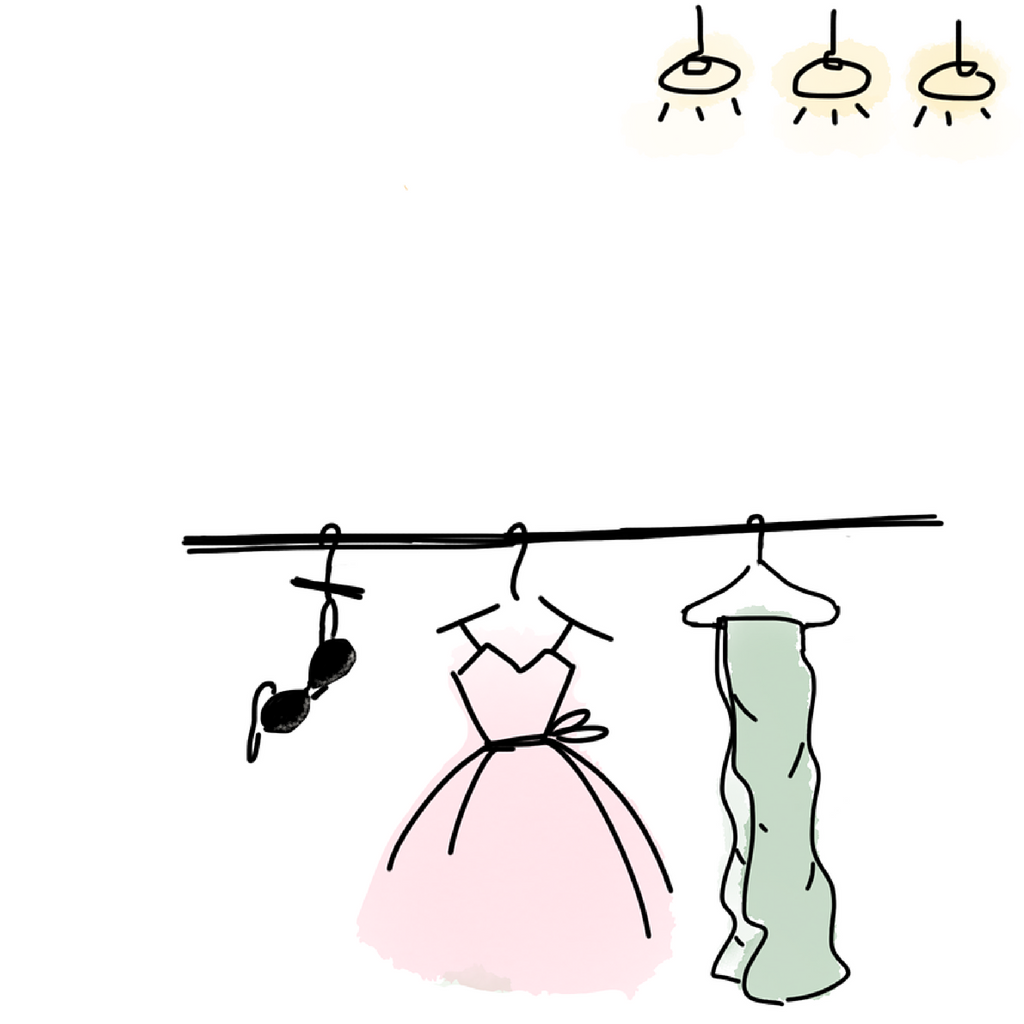 Clothes hanging in closet with bra